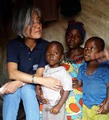 Kyung-Gwha Kang et une famille des déplacés de Mugunga 3